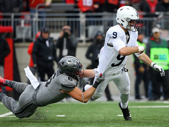 He usually proved elusive, but on this play Penn State quarterback Trace McSorley couldn't escape the grip of Ohio State defensive end Sam Hubbard.