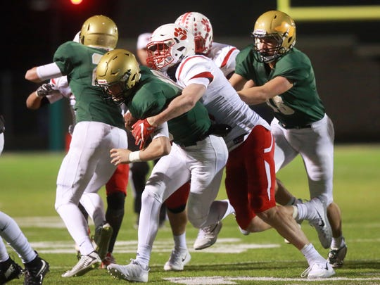 Cedar Falls' Jack Campbell tackles West High quarterback