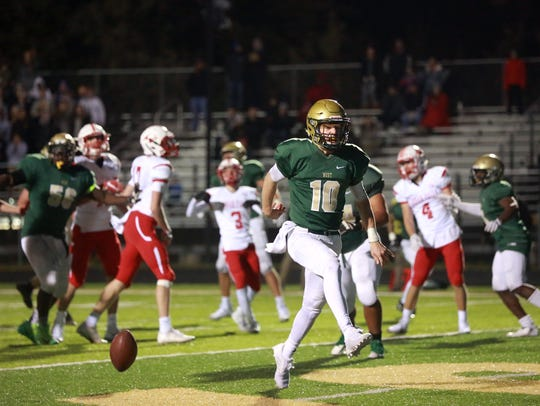 West High quarterback Evan Flitz scores a touchdown