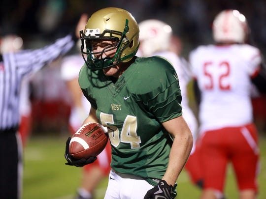 West High's Caden Fedeler recovers a fumble during