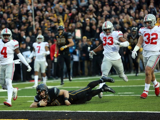 Iowa long snapper Tyler Kluver completes a fourth down