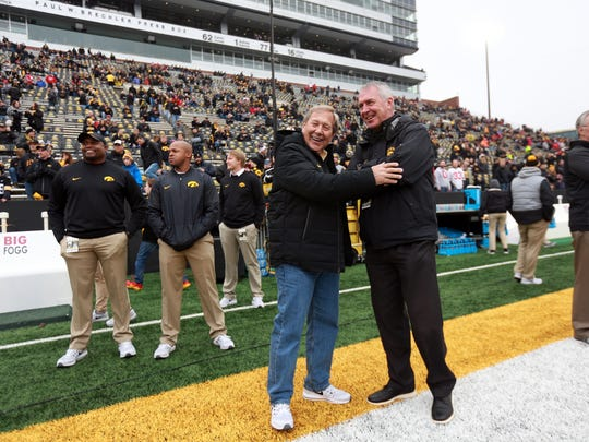 University of Iowa President Bruce Harreld, left, chats with Athletic Director Gary Barta before the Hawkeyes' game against Ohio State at Kinnick Stadium on Saturday, Nov. 4, 2017.