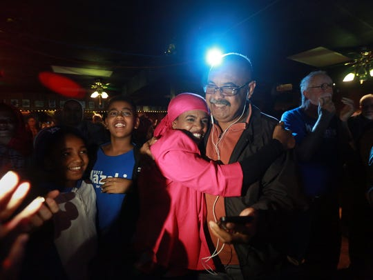 Iowa City City Council candidate Mazahir Salih celebrates