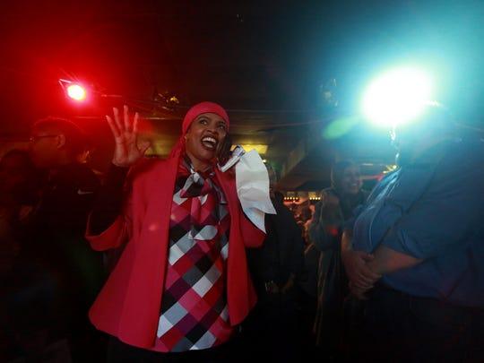 Iowa City City Council candidate Mazahir Salih celebrates