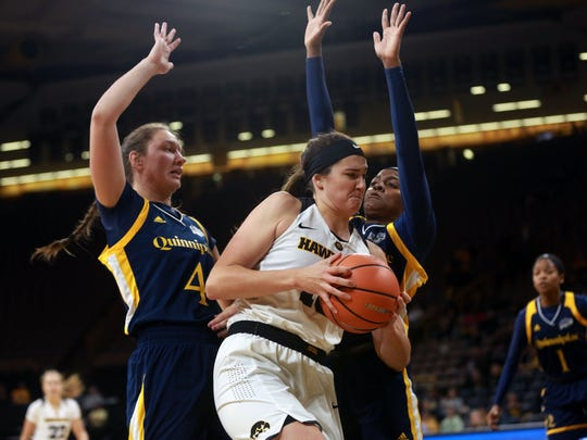 Iowa's Megan Gustafson fights off Quinnipiac defenders during their game at Carver-Hawkeye Arena on Friday, Nov. 10, 2017.