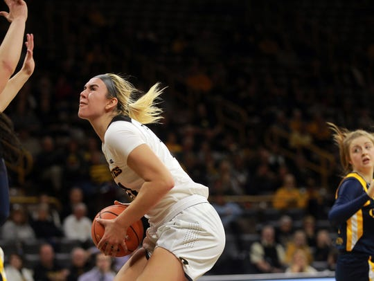 Iowa's Hannah Stewart drives to the hoop during the