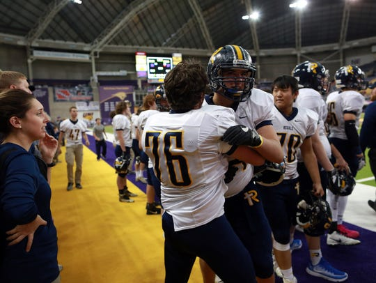 Regina's Nick Boulund (76) and Russell Hingst celebrate