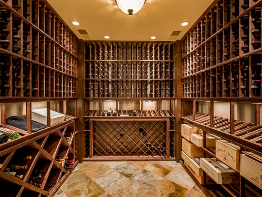 A 1,200-bottle wine cellar feels right at home around
