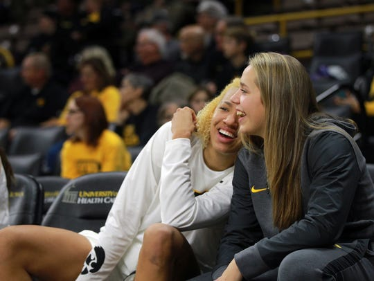 Iowa's Chase Coley, left, and Kathleen Doyle joke around