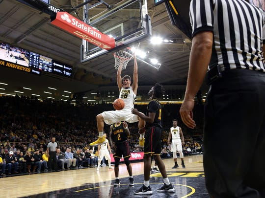 Iowa's Luka Garza dunks the ball during the Hawkeyes' game against Grambling State at Carver-Hawkeye Arena on Thursday, Nov. 16, 2017.