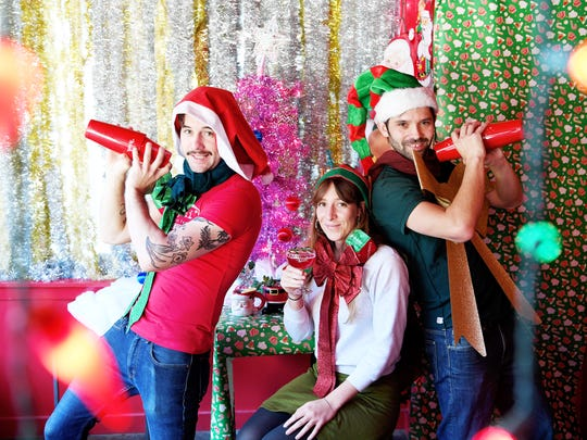 From left, Stephen Murray, Lauren Van Epps and Gabriel Krieg pose for photos at MG Road November 16, 2017, in advance of Miracle on Wall Street, a Christmas-themed pop-up bar. This year, Miracle will move to a different venue, so stay tuned.