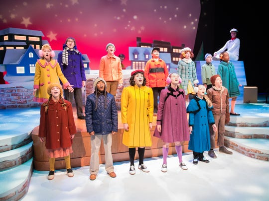 """The cast sings in """"A Charlie Brown Christmas,"""" performed by First Stage."""
