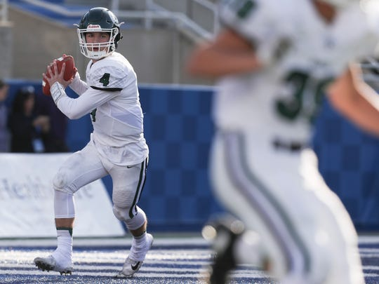 Trinity quarterback Nick Bohn looks for an open reciever in the first quarter during the Commonwealth Gridiron Bowl against St. Xavier at the UK football stadium on Sunday afternoon. Dec. 3, 2017