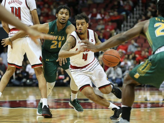 U of L's Quentin Snider drives to the basket during the first half against the visiting Siena Saints on Wednesday evening at the KFC Yum! Center. Dec. 6, 2017