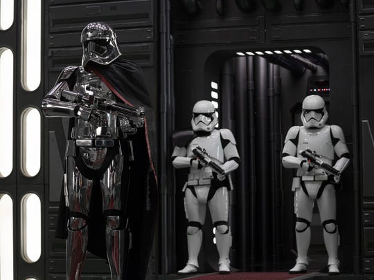 Captain Phasma (Gwendoline Christie, left) leads a battalion of Stormtroopers — and is the lone woman of power in the male-dominated First Order.