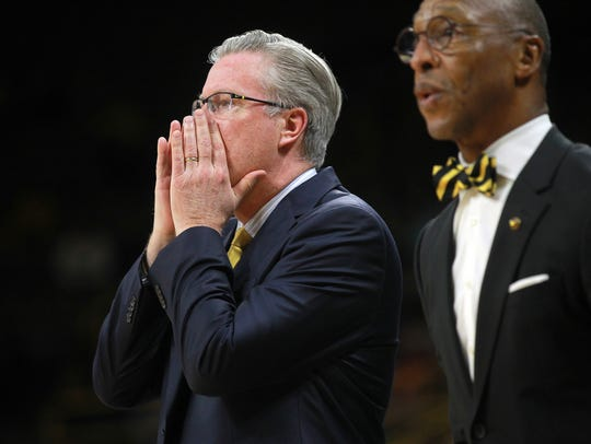 Iowa head coach Fran McCaffery calls to players during