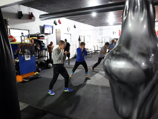 Boxing students run drills during a Rock Steady Boxing class at ICOR Boxing on Wednesday, Nov. 29, 2017. The class helps clients with Parkinson's Disease address symptoms with strength and agility exercises.