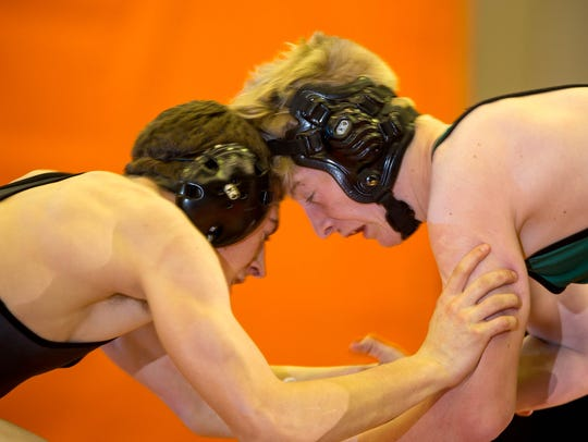 Marshfield's Bentley Ostermann, left, faces off against