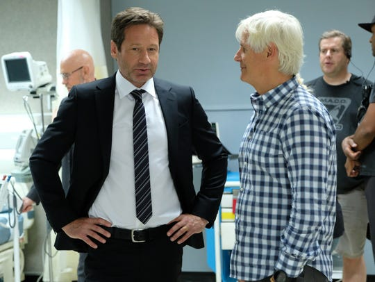 David Duchovny, left, takes to series creator Chris