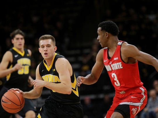 Iowa's Jordan Bohannon takes the ball down court during the Hawkeyes' game against Ohio State at Carver-Hawkeye Arena on Thursday, Jan. 4, 2018.