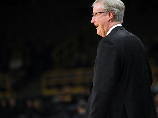 Iowa head coach Fran McCaffery jokes with a referee