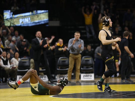 Iowa's Spencer Lee pins Michigan State's Rayvon Foley as they wrestle at 125 pounds at Carver-Hawkeye Arena on Friday, Jan. 5, 2018.