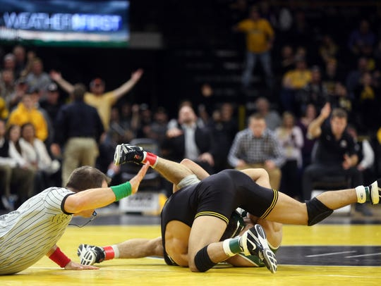 Iowa's Michael Kemerer pins Michigan State's Jake Tucker