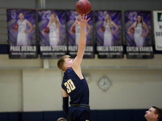 Regina's Even Brauns goes up for the opening tipoff during the Regals' game against Cedar Rapids Xavier in Cedar Rapids on Saturday, Jan. 6, 2018.