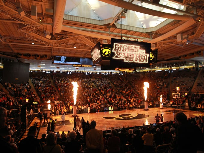 Iowa teammates are introduced before their game against
