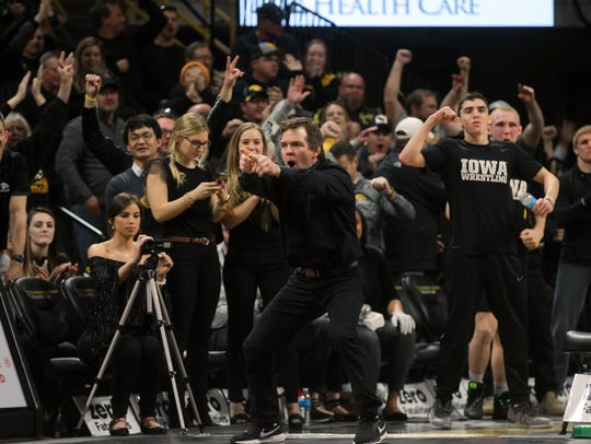 Iowa associate head coach Terry Brands celebrates the