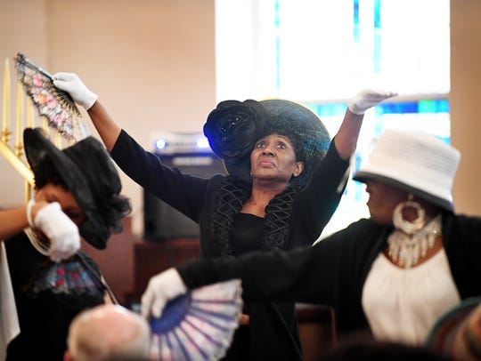 The St. James AME Church Dance Group performs before