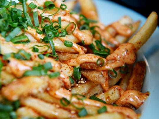 Gan Shan West's Japanese fries with mayo, sweet soy, togarashi, furikake, scallion.