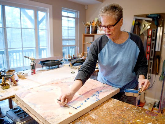 Mary Farmer paints with pigmented beeswax in her studio in her home in South Asheville January 12, 2018.