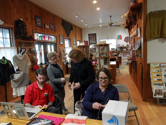 Resist in a Box contributors Nate Huisenga, from left, Edyie Stika, Marcia Rogers and Amanda Nelson gather at the Knitting Shoppe on Friday, Jan. 12, 2018.