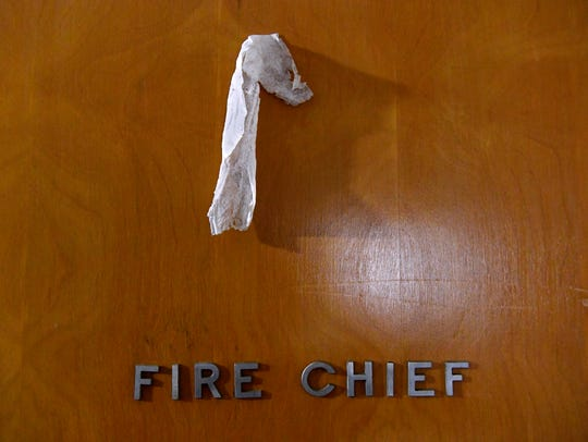 A piece of paper hangs from a hook on the Fire Chief's