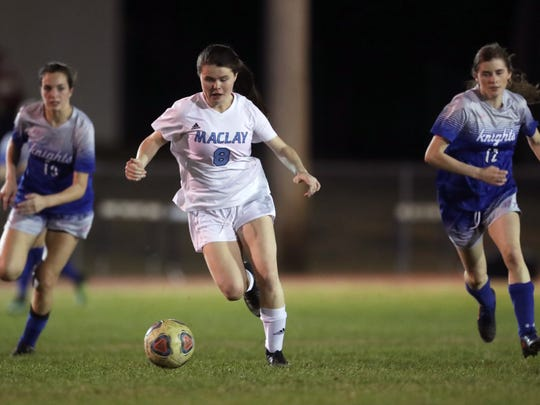 Maclay's Katie Lynch dribbles the ball down field against Rocky Bayou Christian in the Marauder's 2-1 District 1-1A championship win on Friday, Jan. 26, 2018.