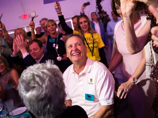 Jon Mason smiles after winning lot 16, Let the Good Times Rolls, during the Naples Winter Wine Festival Auction on Saturday, January 27, 2018 at the The Ritz-Carlton Golf Resort in Naples, Fla. Lot 16 included a 2018 Rolls-Royce Phantom and sold for $780,000.
