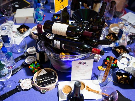 Empty wine bottles litter a table during the Naples Winter Wine Festival Auction on Saturday, January 27, 2018 at the The Ritz-Carlton Golf Resort in Naples, Fla.