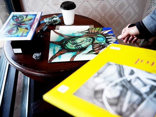 Michael Provard's artwork on a table at Trade & Lore