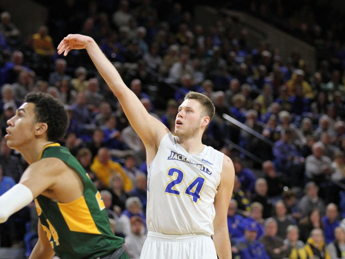 South Dakota State's Mike Daum (5) scores his 2000th