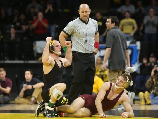 Iowa's Alex Marinelli celebrates his win over Minnesota's Nick Wanzek at Carver-Hawkeye Arena on Friday, Feb. 2, 2018. Marinelli won by decision, 5-1.