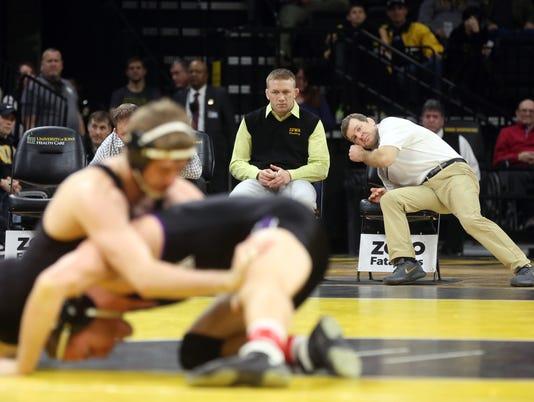 636533477158031125-180204-21-Iowa-vs-Northwestern-wrestling-ds.jpg
