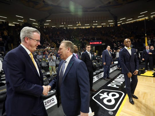 Iowa head coach Fran McCaffery and Michigan State head coach Tom Izzo chat before their game at Carver-Hawkeye Arena on Tuesday, Feb. 6, 2018.