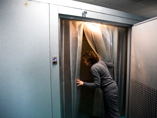 Miriam Pereira, director of development, looks inside the new warehouse refrigerator at the new Harry Chapin Food Bank in East Naples on Wednesday, Feb. 7, 2018. The new location has 13,500 square feet of space.