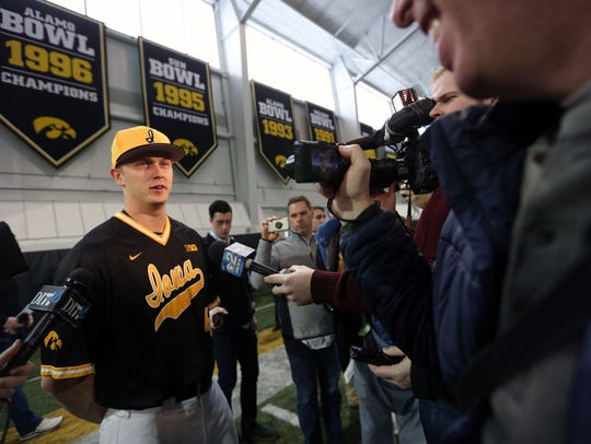 Iowa outfielder Robert Neustrom answers questions during