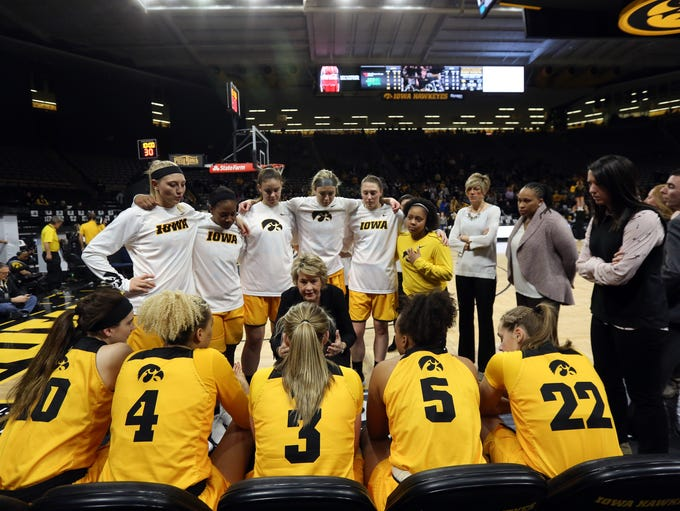 Iowa head coach Lisa Bluder talks to her team before