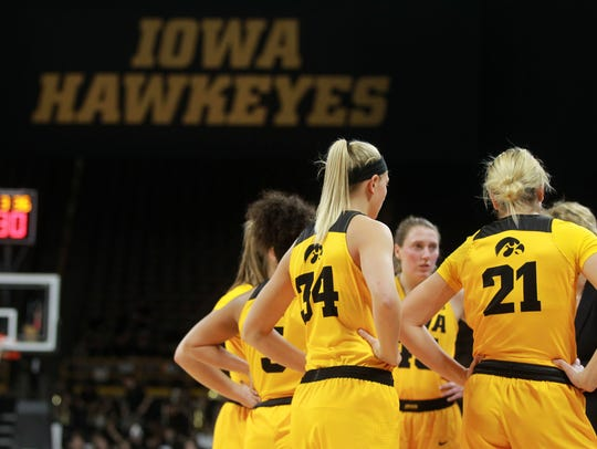 Iowa teammates huddle up during the Hawkeyes' game