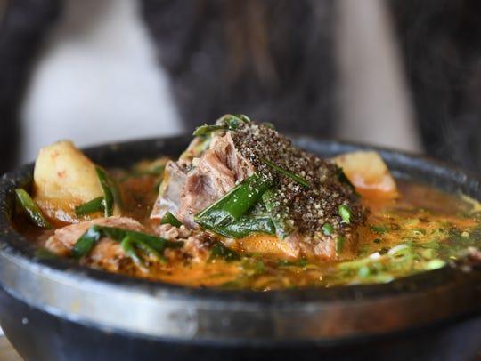 The gamja tang, a potato soup with pork neck bone,