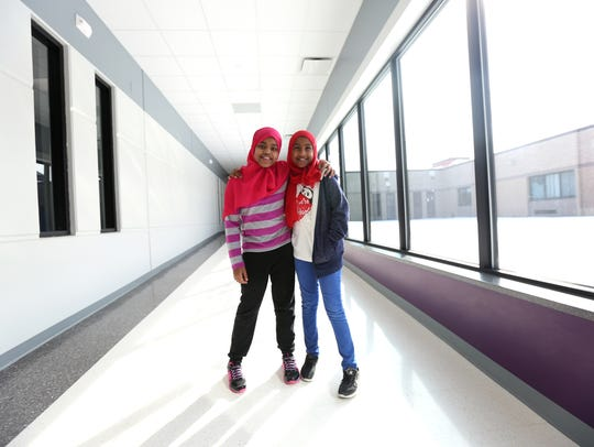 Reem Kirja, 10, left, and Rayan Saeid, 11 pose for