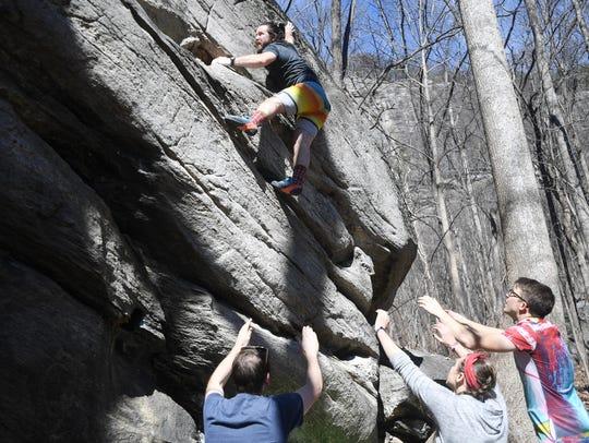 """Ian Rogan, of Cary, climbs the """"Rasta Drop"""" during"""